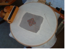 One of the squares being stitched on silk gauze